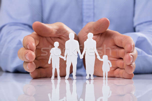 Businessperson Protecting Family Paper Cut Out Stock photo © AndreyPopov