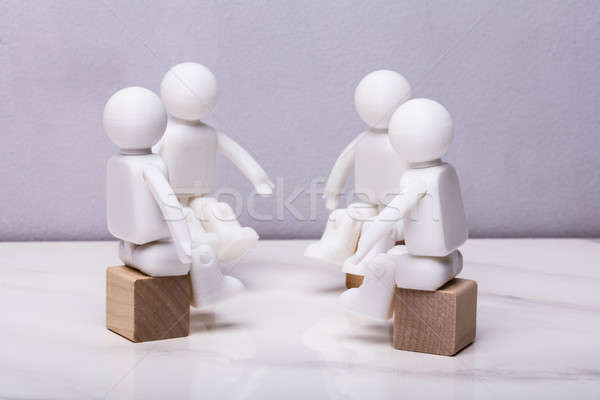Human Figurines Sitting On Wooden Block Stock photo © AndreyPopov