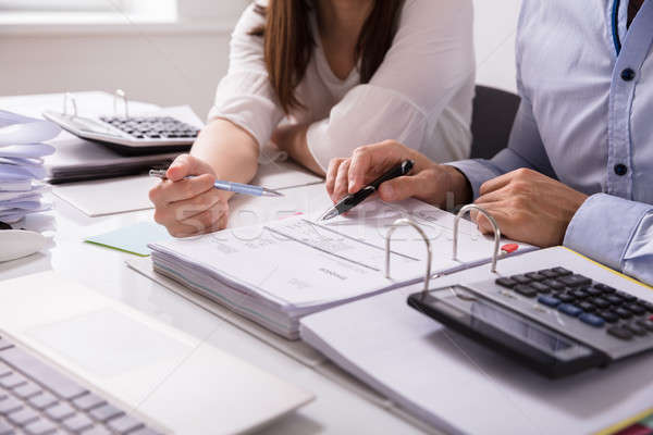 Two Businesspeople Checking Invoice Stock photo © AndreyPopov