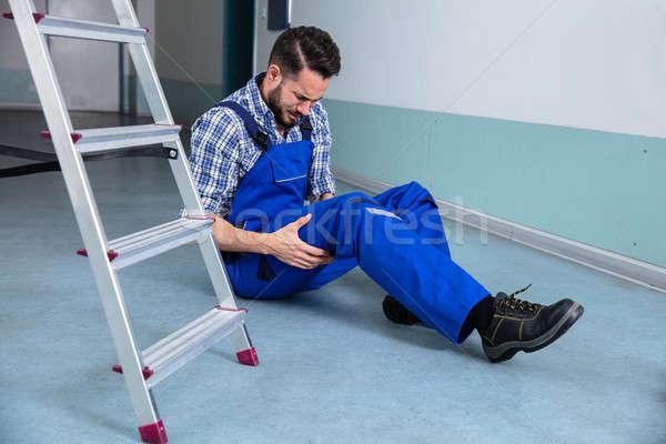 Ezermester megérint sebesült láb zuhan férfi Stock fotó © AndreyPopov