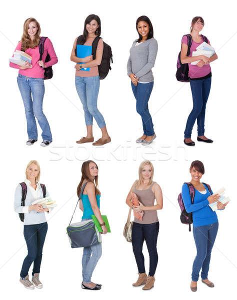 Piękna młodych studentów odizolowany biały kobiet Zdjęcia stock © AndreyPopov