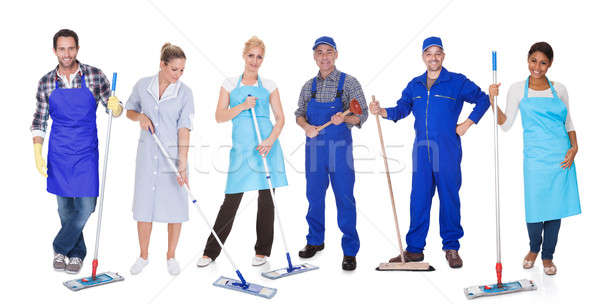 Group Of Cleaners With Mop Stock photo © AndreyPopov