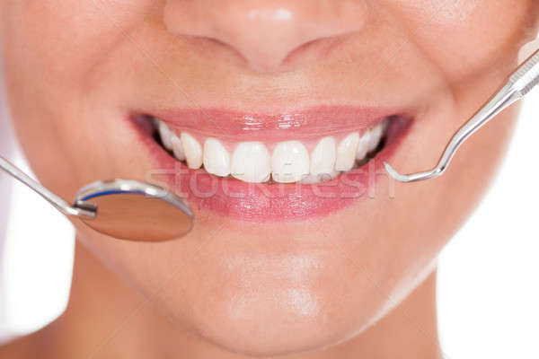 Smiling woman with perfect white teeth Stock photo © AndreyPopov