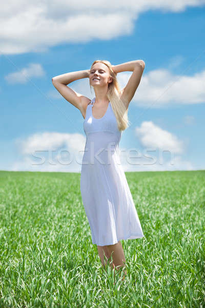 Happy Young Woman In Grassland Stock photo © AndreyPopov