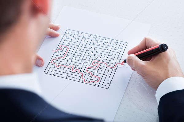 Közelkép kéz puzzle labirintus piros toll Stock fotó © AndreyPopov