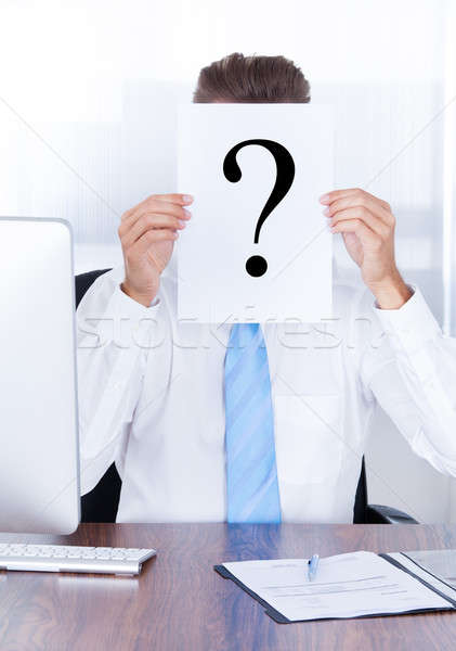 Businessman Holding Question Mark Sign On Paper Stock photo © AndreyPopov