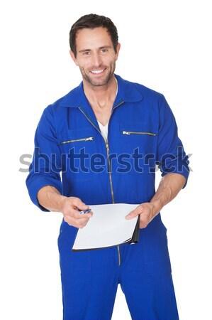 Portrait of happy automechanic writing invoice Stock photo © AndreyPopov