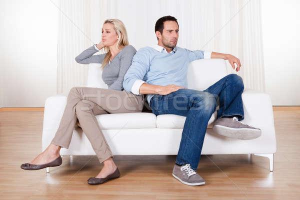 Pár ki nézeteltérés ül kanapé család Stock fotó © AndreyPopov