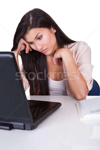 Nő bámul laptop fiatal üzletasszony ülő Stock fotó © AndreyPopov