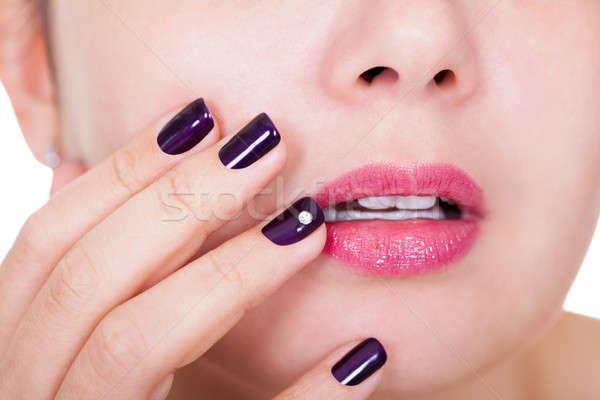 Beautiful nails and lips Stock photo © AndreyPopov