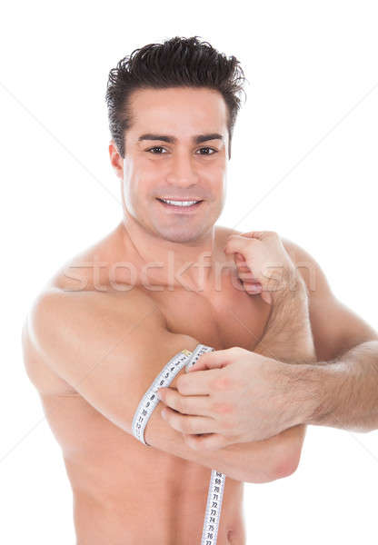 Muscular Man Measuring Biceps Stock photo © AndreyPopov