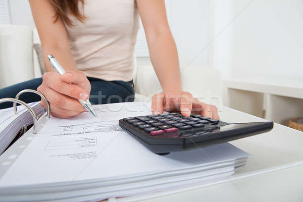 Nő otthoni pénzügyek asztal fiatal nő pénz papír Stock fotó © AndreyPopov