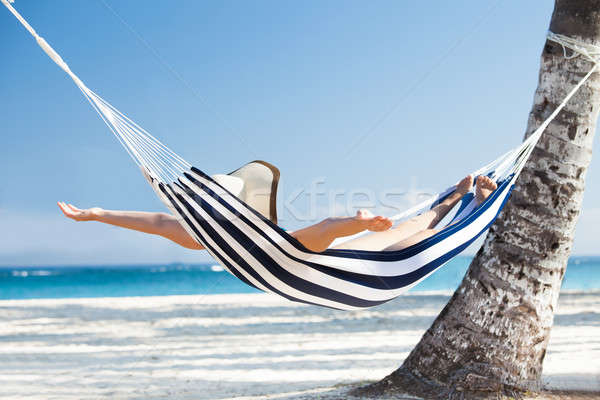 Woman Stretching In Hammock At Beach Stock photo © AndreyPopov