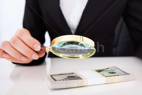 Businesswoman Scrutinizing Dollar Bills With Magnifying Glass Stock photo © AndreyPopov