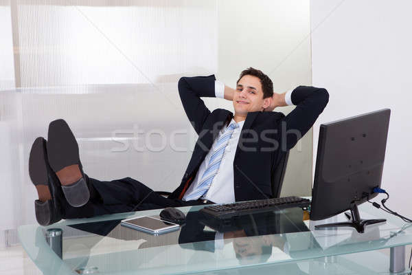 Nyugodt üzletember álmodozás iroda teljes alakos asztal Stock fotó © AndreyPopov