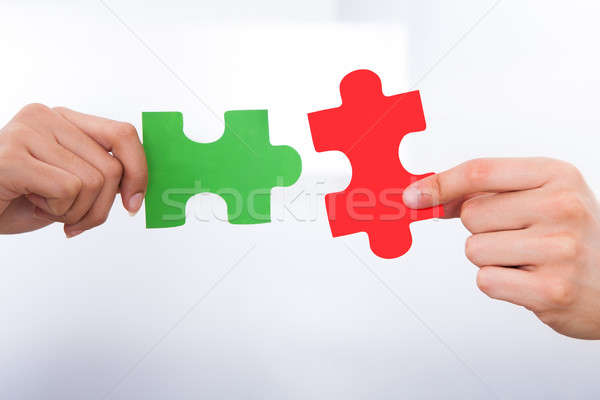 Hands Joining Puzzle Pieces Stock photo © AndreyPopov
