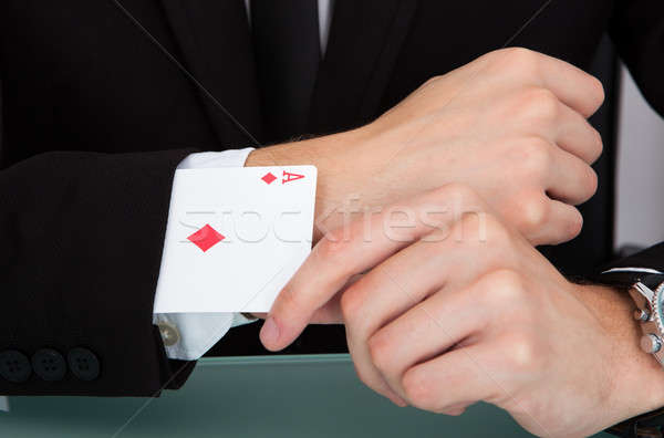 Businessman With Playing Cards In Sleeve Stock photo © AndreyPopov