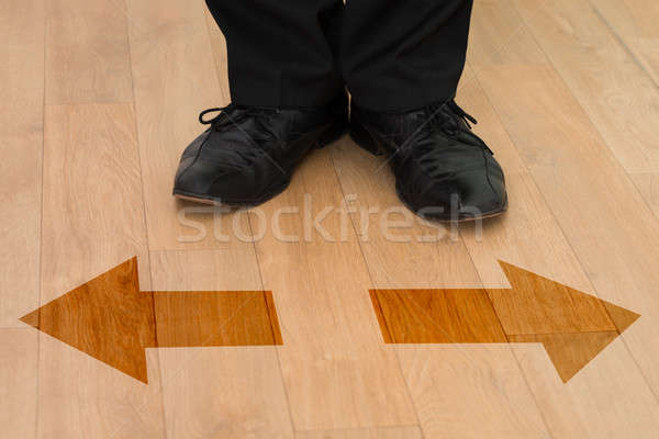 Standing In Front Of Left Or Right Arrows On Floor Stock photo © AndreyPopov