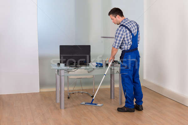 Man Cleaning Floor In Office Stock photo © AndreyPopov