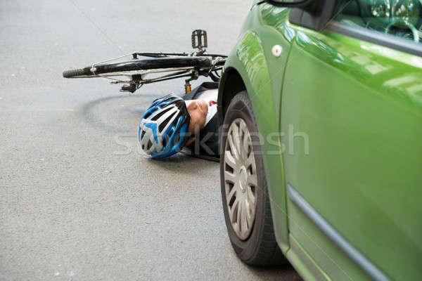 Férfi kerékpáros út baleset eszméletlen utca Stock fotó © AndreyPopov