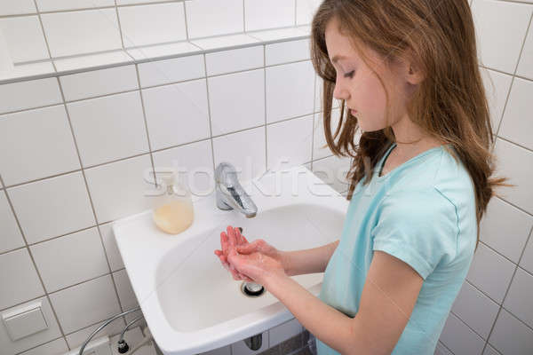 Girl Washing Hands In Sink Stock photo © AndreyPopov