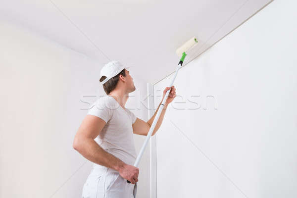Painter Painting On Wall Stock photo © AndreyPopov
