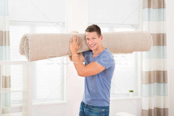 Homme roulé tapis portrait heureux Photo stock © AndreyPopov