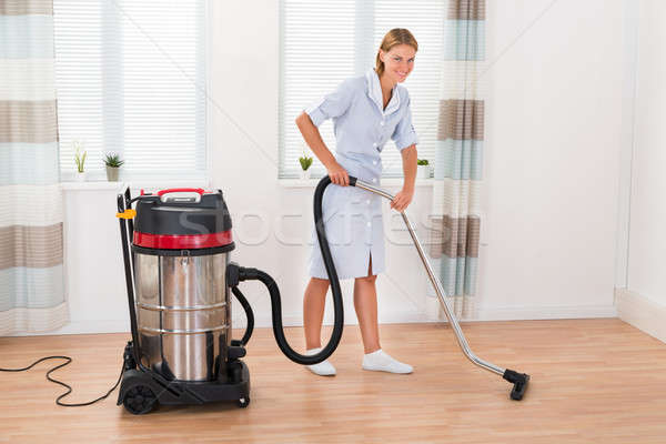 Female Maid With Vacuum Cleaner Stock photo © AndreyPopov