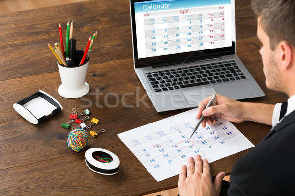 Businessman Marking Date On Calendar Stock photo © AndreyPopov