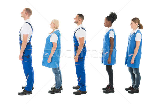 Side View Of Multiethnic Janitors Standing In Queue Stock photo © AndreyPopov