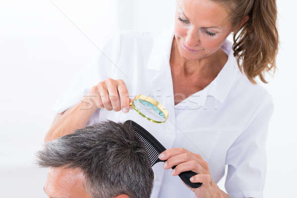 Dermatologist Looking At Patient's Hair Stock photo © AndreyPopov