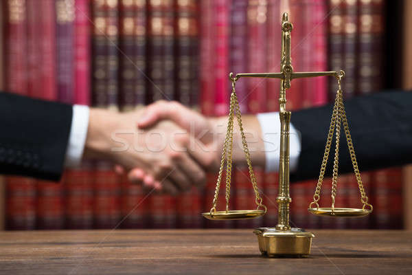 Justice Scale On Table With Judge And Client Shaking Hands Stock photo © AndreyPopov