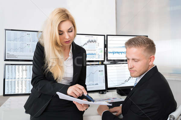 Financial Analysts Discussing Over Documents In Office Stock photo © AndreyPopov