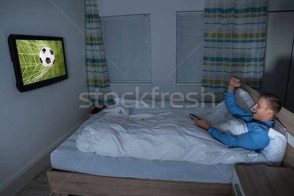 Homem assistindo futebol combinar televisão moço Foto stock © AndreyPopov