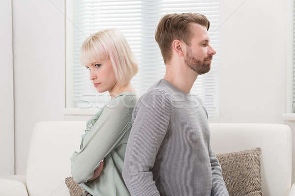 Couple Sitting Back To Back On Couch Stock photo © AndreyPopov