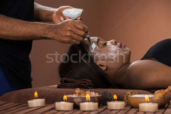 Woman Getting Facial Mask At Spa Stock photo © AndreyPopov