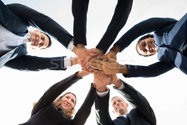 Businesspeople Stacking Hands Over Each Other Stock photo © AndreyPopov