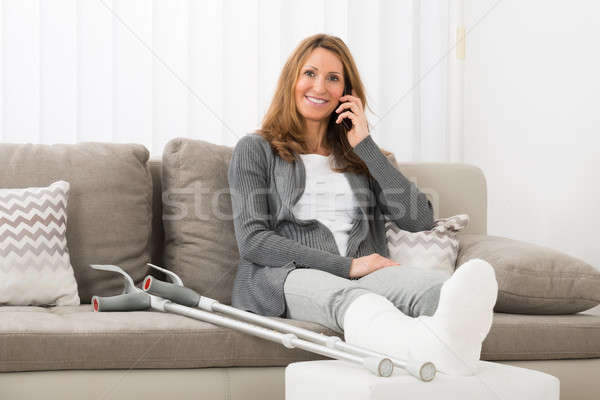 Woman With Plastered Leg Talking On Mobile Phone Stock photo © AndreyPopov