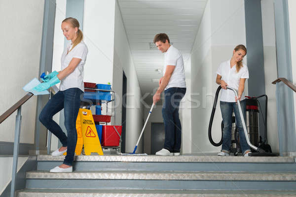 очистки коридор оборудование группа счастливым мужчины Сток-фото © AndreyPopov