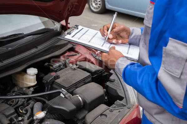 Mechanic Checking Car Engine Stock photo © AndreyPopov