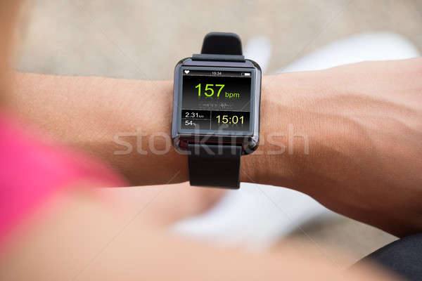 Human Hand Wearing Smart Watch Showing Heartbeat Rate Stock photo © AndreyPopov