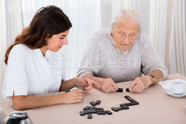 Two Women Playing Domino Game In Hospital Stock photo © AndreyPopov