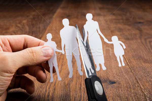 Person Cutting Papercut With Scissor Stock photo © AndreyPopov