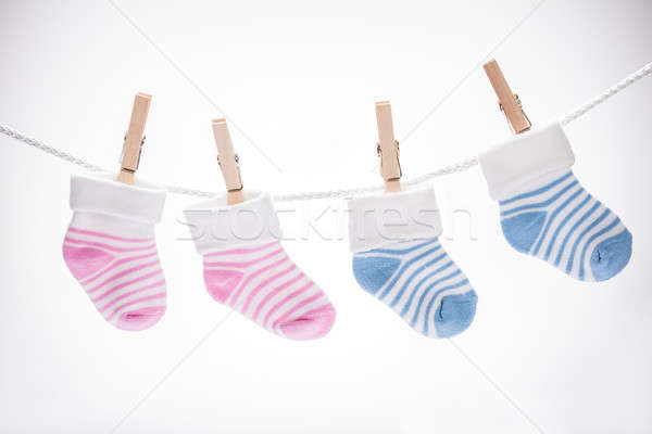 Pair Of Baby Sock Hanging On Rope Stock photo © AndreyPopov