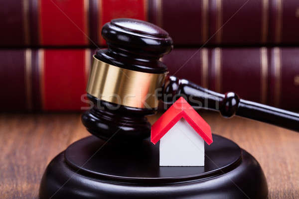 House Model With Gavel On Wooden Table Stock photo © AndreyPopov