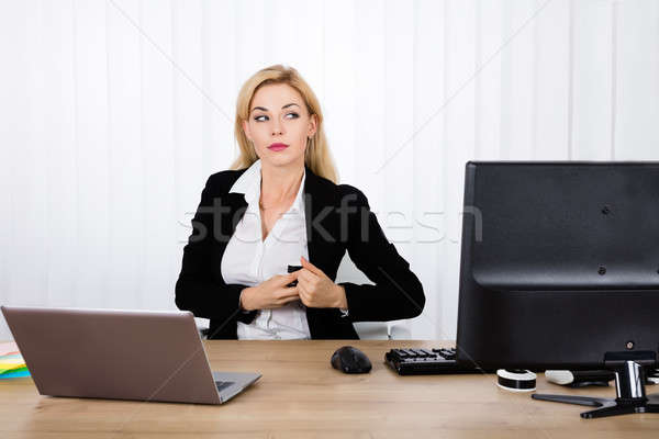 Businesswoman Stealing Stapler Secretly Stock photo © AndreyPopov