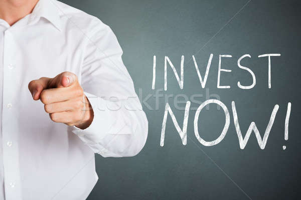 Businessman Gesturing To Invest Now Stock photo © AndreyPopov