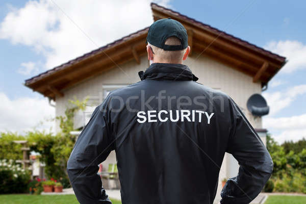 Stock photo: Security Guard Standing Outside The House