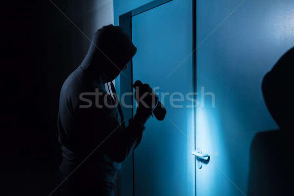 Ladrão fora porta escritório Foto stock © AndreyPopov