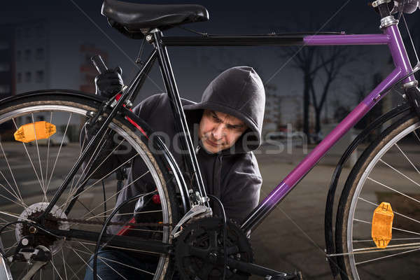 Thief Breaking The Bicycle Lock Stock photo © AndreyPopov